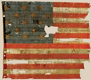 "The actual flag flown over Ft. McHenry in 1814 that inspired Francis Scott Key to write ""The Star Spangled Banner."" The flag has been preserved and is now one of the most treasured artifacts in the collection of the Smithsonian's National Museum of American History in Washington D.C."